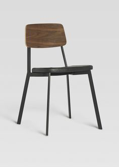 The Sprint Grand Side Chair with Upholstered Seat is steel with an upholstered seat and a wood veneer seat back. Stackable.