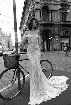Sweet and sexy off shoulder lace bridal gown, long train, made for romance! Urban setting, bicycle