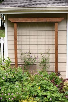 DIY Garden Trellis out of pressure treated wood and cattle fencing #gardentrellis #gardenfences