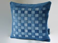 Upcycled, recycled, rescued denim jeans and miscellaneous denim scraps from previous projects now have a new life, a denim pillow cover for
