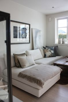 idea:  make corner sectional from scratch  1. figure out how to cut mattresses to be cushions  2. wrap mattress with memory foam (mmm...cushy)  3. make frame from wood + plywood + foam  4. cover with canvas drop cloths with stapler  5. make slipcovers (white which can be washed)  6. gather family and watch movie with popcorn