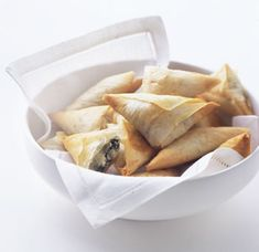 Spinach and feta triangles...trick is to cook spinach just until it wilts and get all the moisture out of it.