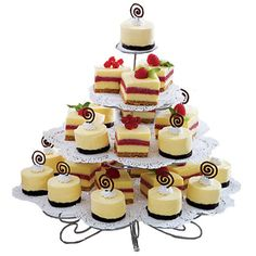 Tantalize taste buds with A Round of Cheesecakes. Individual vanilla and raspberry cheesecakes are topped with candy swirls or fresh fruit. Display the dainty delights on the Cupcakes ?N More Dessert Stand.