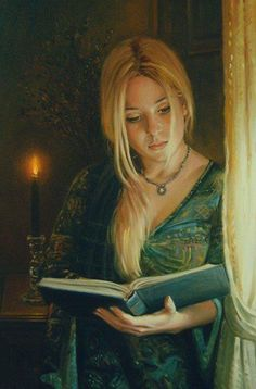 lost in a book, the expression on her face says it all, looks ike a book that id read, she looks truly captivated