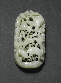 JP: A FINELY CARVED PALE CELADON JADE PLAQUE, CHINA, YUAN/MING DYNASTY