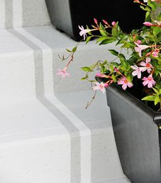 Easy inexpensive way to transform your front steps - I don't have steps but it would look great on my front walk.