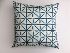 Cushion cover in a striking turquoise batik/shibori style design on white background in cotton fabric. The covers are backed with a beige linen twill fabric which complements the front fabric and they have a concealed zip closure at the bottom edge of the cover. The covers are available in three sizes: 60 x 60cm/24 x 24, 50 x 50cm/20 x 20 or 50 x 30cm/20 x 12 (cover itself is sized a little smaller in order to make the cover a good fit). Please contact me if you require a...
