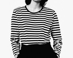 Parisian chic with this Marimekko Tasaraita black and white stripe tee. Tuck into boyfriend jeans and wear red lipstick for the ultimate smart casual minimal outfit.