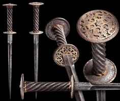 "A Rare Decorated Rondel Dagger, Italian/South German, 1st quarter of the 16th century  Double-edged blade of hollowed diamond section with a pronounced ricasso. Helically cut iron grip and bronze grip ferrules retaining some of their gilding. Slightly different sized discs on both ends with corded and gilt bronze borders. Engraved and gilded, decorative floral bronze openwork overlays riveted on the top and bottom.   Overall length: 36.5 cm (14.37"")  Copyright © Hermann Historica Auction…"
