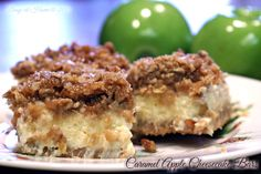 """These delicious Caramel Apple Cheesecake Bars taste like """"more"""" and are a perfect slice of warm, spicy Fall flavors, blended with creamy cheesecake and crunchy struesel. Yum!"""