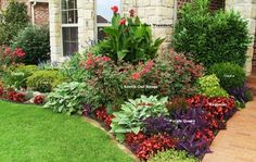 Front Entry Flower Bed with names so that you can replicate or use similar plants that are more suitable to your area/climate conditions.