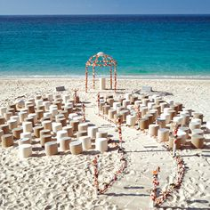 Love this whimsical set-up for a beach wedding ceremony!