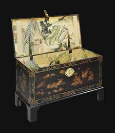 A GEORGE II CHINESE LACQUER AND JAPANNED CHEST   MID-18TH CENTURY   DECORATED OVERALL WITH GILT HEIGHTENED SEA-LIFE, COCKERELS AND ROCKY OUTCROPS, WITH PIERCED BRASS ESCUTCHEON, THE INTERIOR PAPER LINED WITH GOUACHE DECORATED CHINOIERIE LANDSCAPES, ON LATER BRACKET FEET