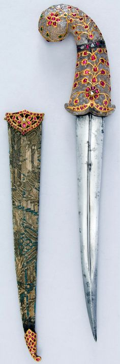 Indian (Mughal) jambiya dagger, 18th century, kundan work (gems set with gold foil), steel, rock crystal, gold, silver, rubies, diamonds, emeralds, textile, wood,  L. 15 3/4 in. (40.01 cm), Bequest of George C. Stone, 1935, Met Museum.