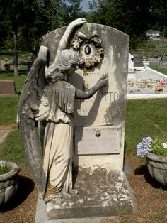 Angel writing name of deceased on tombstone at Holy Sepulchre Cemetery in Omaha, NE.  Celestial Reflections Photography