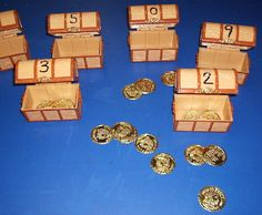 pirates- Write numbers on plastic treasure chests and count the correct number of gold pieces into each one.