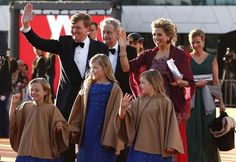 Their majesties and their daughters enjoy the crowds after they ascend the throne of Holland 4/30/13