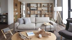 MUJI Home. Dark wooden floor with ash color furniture and cotton texture sofa. Simple yet elegant