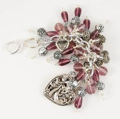 Purple Hearts Purskey, use as a purse charm on clutch bags, wristlets, handbags, back packs, and more. You can also use it as a key chain
