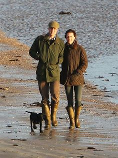 Kate Middleton, Prince William and Royal Cocker Spaniel pup Lupo- meaning: 'wolf' in Italian.