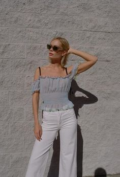 The Sandy Liang Ibiza Top is a dusty blue smocked top.