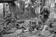22 Nov 1967, Dak To, South Vietnam --- In Battle. Dak To, South Vietnam: A member of the 173rd Airborne Brigade crouches beside the body of a dead comrade and equipment left by wounded at the height of the battle on Hill 875. U.S. Army paratroopers of the 173rd Airborne Brigade began a final assault up the bloody slopes of Hill 875. ---