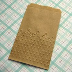 Embossed lunch sack... I thought of this idea myself too, but didn't have time to do it today.. Love to give credit to the person who's image this is. .