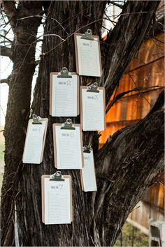 table assignment clipboards hung from a tree concept by Jen Rios Weddings, designed by Yeti The Beast Wedding Table Assignments, Seating Plan Wedding, Wedding Table Numbers, Seating Plans, Trendy Wedding, Rustic Wedding, Bear Wedding, Seating Cards, Braided Hairstyles For Wedding