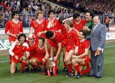 Liverpool celebrate with the Milk Cup (back row, l-r): Mark Lawrenson, David Fairclough, Alan Hansen, Ronnie Whelan, Ian Rush, Bruce Grobbelaar, Bob Paisley; (front row, l-r): Craig Johnston, Kenny Dalglish, Phil Neal, Graeme Souness, Sammy Lee, Alan Kennedy