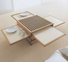 This is a such a cool idea: similar to a keyboard tray on a desk, the Hexa coffee table has six hidden compartments that slide out to triple the available surface area, perfect for parties and when you want to have dinner on the couch, or just to have