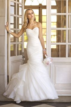 Perfect silhouette for lots of accessories! Style #5835 features organza pleats and flirty skirt I @Stella York I #weddinggown