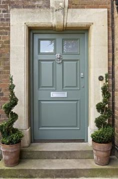So in love with this sea green front door. Inviting and charming.