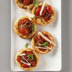 Sweet Onion-Tomato Tartlets    Puff pastry topped with roasted sweet onion and grape tomatoes bakes into an easy party pleaser.
