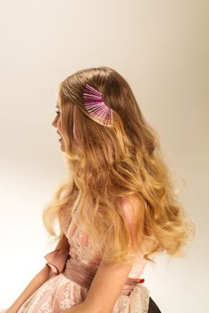 Soft curls, shades of pink and colorful hairpins are simply perfect for a Big Night Out. #DressUpPartyDown