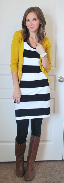 Striped dress, mustard cardi, brown boots with tights.