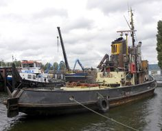 """This Dutch tugboat, the """"Port of Beyrouth"""", was scuttled at Dunkirk in June 1940 but then raised and requisitioned by the KMD (Kriegsmarine Dienststelle - Naval Coordinator of Merchant Shipping) for use in Operation Sealion. It was renamed """"Lauenburg"""". Tugs were to be used to tow the invasion barges across the English Channel. Eventually, 170 cargo ships, 1277 barges, and 471 tugs were gathered. These were, inevitably, bombed by the RAF (about 10% being sunk before they dispersed again). Operation Sea Lion, English Channel, Tug Boats, Luftwaffe, World War Two, Ww2, Britain, Diesel, Dutch"""