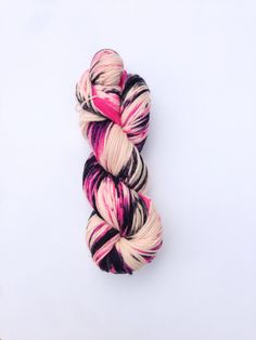 Flamingo Assassin is a Superwash Merino DK weight yarn hand dyed with splashes of hot pink, light pink, and black.  100% Superwash Merino Wool