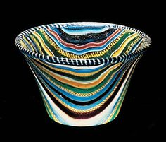 A brilliantly colored glass cup was made in the Roman Empire from ribbons of glass in about the 1st century A.D. Corning museum of glass