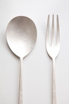 Yuki Sakano cutlery — 'Each piece is made by Yuki herself from solid Nickel silver, and then plated again one last time with pure silver. You can keep the beautiful light colour by polishing with a soft cloth, or as Yuki would intend, enjoy the tarnished silver as it naturally oxidizes.'