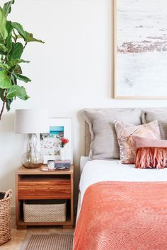 Swap in new throws and pillows for a seasonal pop of color. Or switch up the nightstand by adding a new piece of art, no hammering required. For more easy bedroom ideas and updates, click through the gallery.