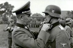 "Paul ""Papa"" Hausser decorates Ludwig Kepplinger with the Knights Cross of the Iron Cross."
