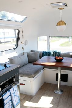 """""""Our cozy dinette also features a telescoping table leg that lowers down and forms a HUGE couch/guest bed."""""""
