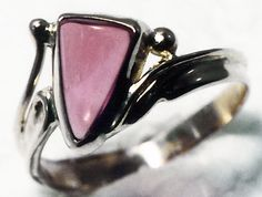 Unique ring featuring a garnet cabochon. #customjewelry #oneofakind #ring #GoldcraftersCorner