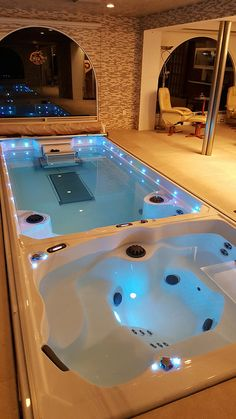 From Endless Pools®, this 19' Dual-Temperature Swim Spa lets you swim or exercise at a comfortable 84° F and then enjoy hot-tub hydrotherapy at a relaxing 100° F. Request your Free Idea Kit at www.endlesspools.com.