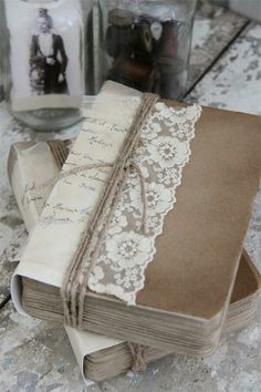 what a cool idea to re cover the books i love with lace and paper bag cover, jewery, and writings and poems i love. what a cool hobby