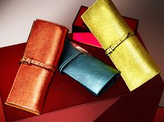 Clutch bags in tangerine, petrol blue and cowslip metallic leather from the Burberry Prorsum Spring/Summer 2013 Accessories Collection