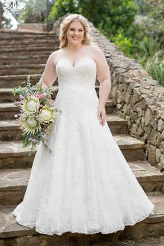 Classic lace A-line styling strapless gown. The feature is the layering of lace on lace, creating a