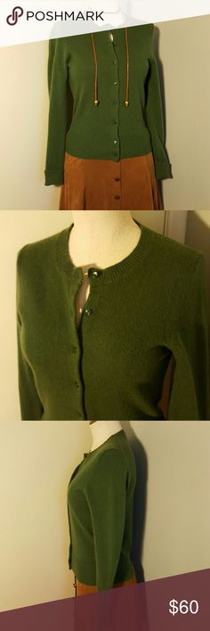 """J.Crew Green Cashmere Cardigan Sweater S Beautiful green 100% super soft cashmere cardigan by J.Crew.  Size Small. rounded neckline, green pearlescent buttons, ribbed neckline, cuffs, and hem.  Looks amazing with tan brown this Fall/ Winter!   Great used condition with minimal wear.  Comes dry cleaned.  Measures 32"""" around the bust, is 21"""" long. J. Crew Sweaters Cardigans"""