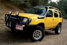 Four Wheeler Magazine& 2001 Nissan Xterra project suv gets a winch, snorkel and off-road lights. Read all the details inside Four Wheeler Magazine. Nissan Xterra, Nissan 4x4, Nissan Trucks, Best Atv, Black Hood, Four Wheelers, New Tyres, T 4, Custom Cars