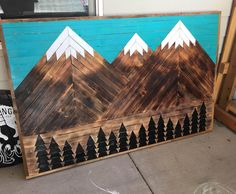 Give your wall that WOW factor with a handmade, carefully crafted Reclaimed Wood Geometeric Mountain piece by Scavenger Woodworks. This particular example was inspired by the Three Sisters here in Bend, Oregon, but we would love to recreate your own favorite mountain range so bring on those ranges from Colorado, California, Montana, Washington, etc! Sky color is also customizable.  Each piece is made with unique wood, as we pride ourselves for using what we have available to us to create art…
